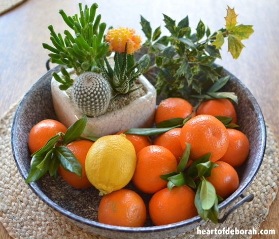 Add greens to your fruit bowl for a simple Christmas decoration.