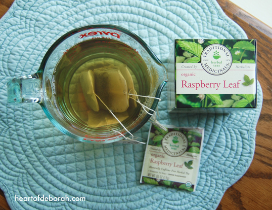 Drinking red raspberry leaf iced tea during pregnancy may ease labor pains. Here is a recipe for red raspberry leaf iced tea using lemonade as a sweetener.
