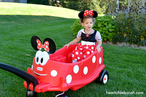 Trick or treat in style this year with a DIY Minnie Mouse Wagon to match your child's Minnie Mouse costume. This is an easy and simple DIY transformation.