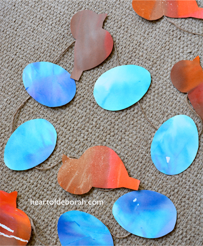 Looking for a fun spring kid's craft? Make this beautiful watercolor robin's nest spring garland with your children! They will love this kid's activity.