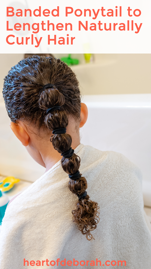 Use a banded ponytail to lengthen naturally curly hair without heat! Everything You Ever Wanted to Know About Curly Hair Care For Kids #biracialhair #naturallycurlyhair #curlyhaircare #mixedhair