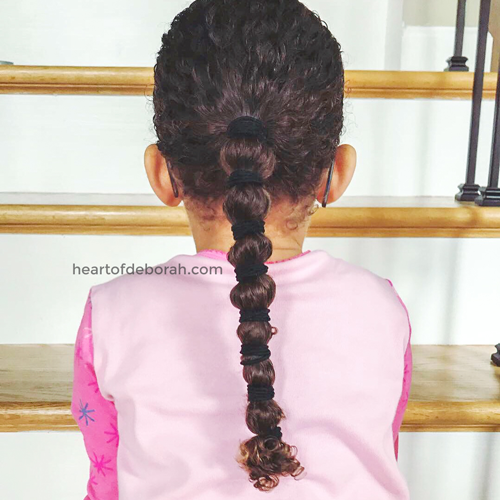 Not sure how to care for your children's curly hair? In this post we share the best curly hair routine for moisture and curl definition. Our daughter is biracial and has dense curls! Throughout the years we've found products that work the best to keep her hair healthy. #curlyhair #curls #kidscurls #biracialhair