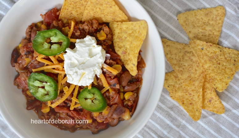 Looking for a savory and flavorful vegan taco soup recipe? This chili is the perfect football season recipe. Your whole family will love it!