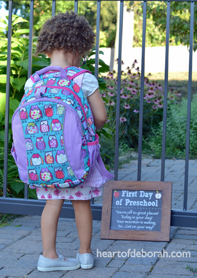 Our daughter's first day of preschool. We documented back to school with this cute sign. Want a first day of school sign for your child? Download one here!