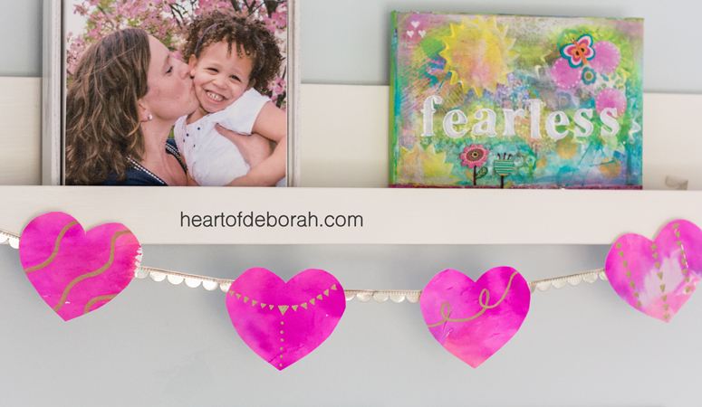 A fun and simple kid's craft to make watercolor hearts. Use the watercolor heart as a decoration for Valentine's Day or as kid's bedroom decor!