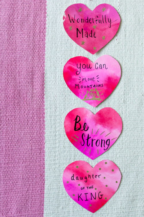 Do you want to speak live over your child? Try using these 14 Christian positive affirmations to shower your kids with love. You can craft the watercolor hearts yourself or download the free printable with biblical positive affirmations.