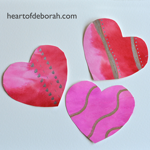A fun and simple kid's craft to make watercolor hearts. Use tissue paper to create a beautiful watercolor heart design. You can use the hearts as Valentine's Day decorations or all year long as kid's bedroom decor!