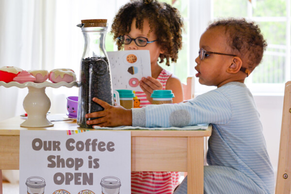 Pretend play is a preschooler's dream! Set up this dramatic play coffee shop and your kids will love taking your order. Don't forget to download the free printable coffee shop sign and order form. Your toddler will love making your coffee and warming up the donuts.