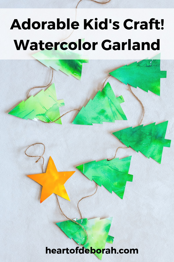 How cute is this Christmas tree craft? Make a watercolor garland with your kids.