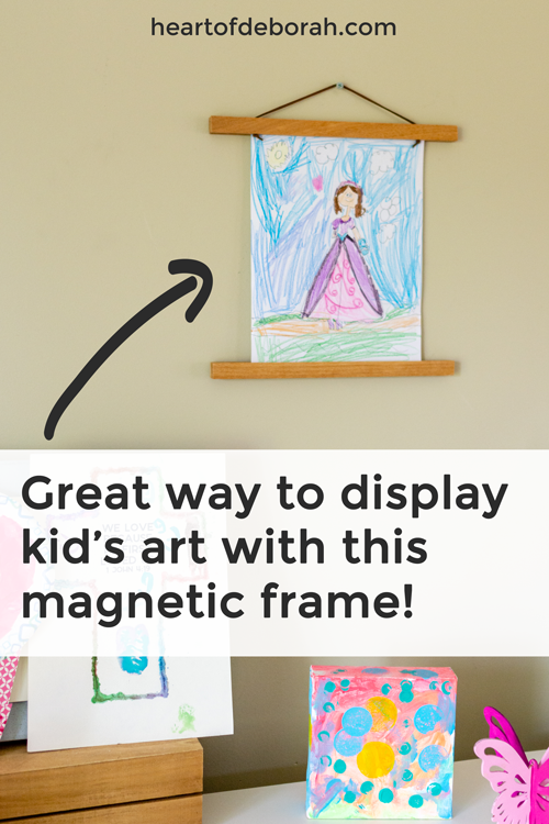Looking for a reusable frame to display your kid's art? Switch out their kid's crafts easily with this magnetic frame. So easy to use and it looks great displayed! #homedecor #kidsart #frame #forthehome