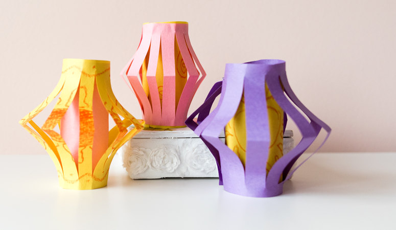 An easy kid's craft inspired by Disney's Tangled! Step by step instructions to make DIY paper lanterns with household materials. A fun craft for young kids.