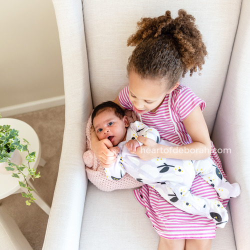 Give the older kids jobs to encourage a bond between new siblings. My daughter loves to sing patty cake to her new baby sister.