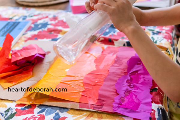 Tissue paper watercolor is so fun and easy! Your kids love will this activity. Make your own sunset with reds, orange, purple and pink.