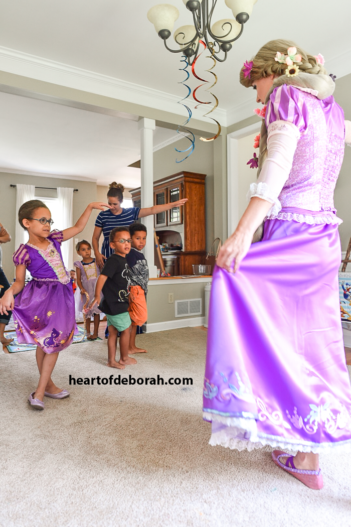 Rapunzel giving us twirling lessons at the birthday party.
